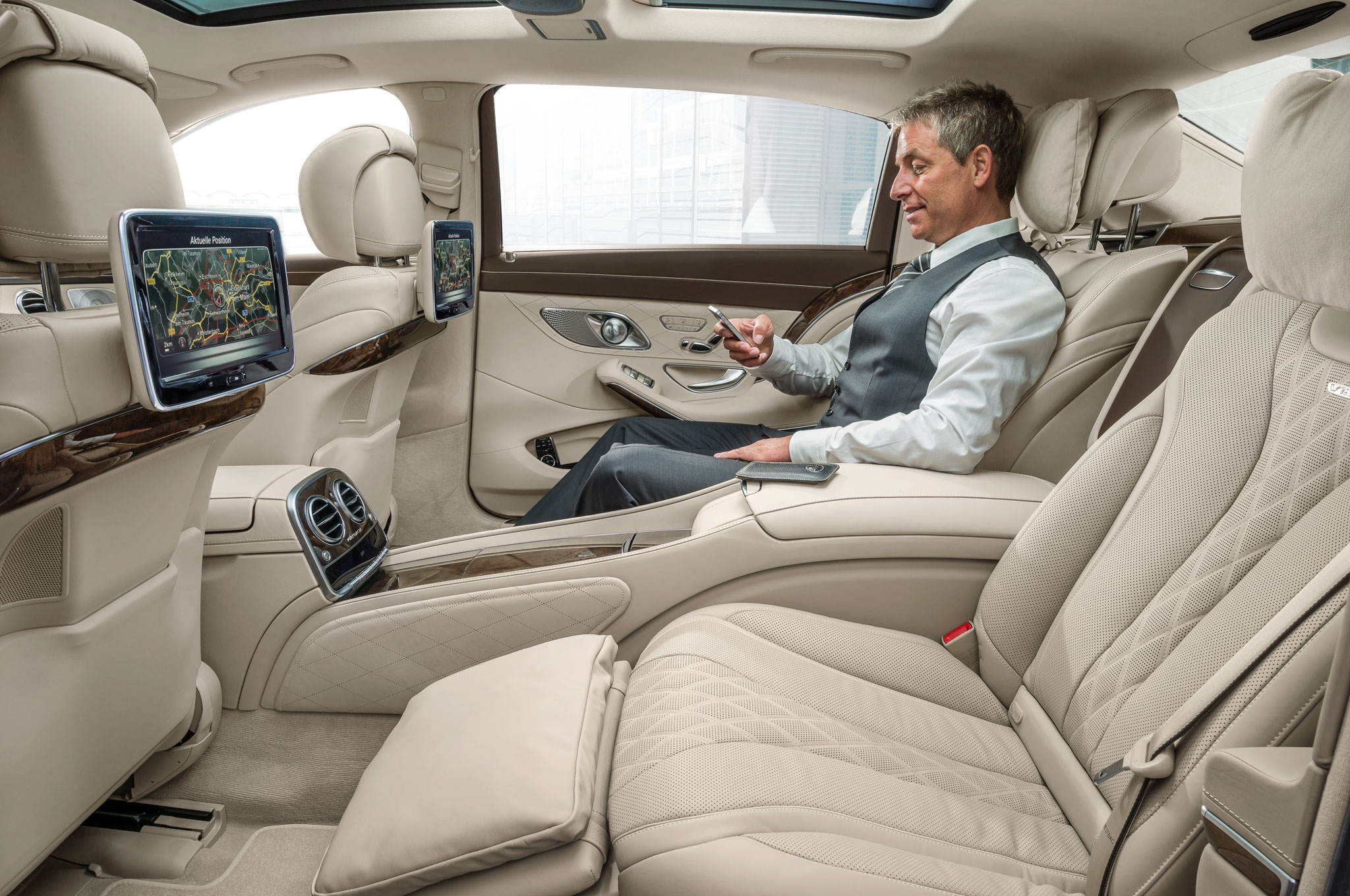 2016-Mercedes-Maybach-S600-rear-seats-with-person-2
